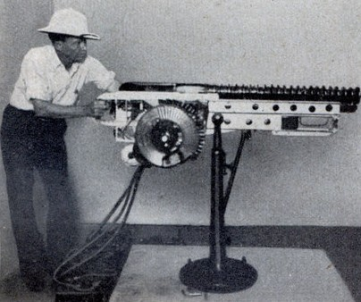 "Mr. Rigsby next to a mockup of his ""electric machine gun"" (Via davidszondy.com). How badass looking is that?"